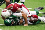 New York Jets quarterback Joe Flacco (5) is sacked by Arizona Cardinals linebacker Dennis Gardeck (45) during the first half of an NFL football game, Sunday, Oct. 11, 2020, in East Rutherford. (AP Photo/Seth Wenig)
