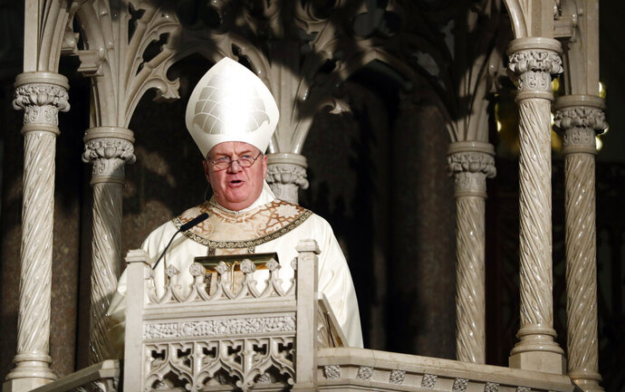 """FILE - In this Jan. 6, 2017 file photo, Cardinal Joseph Tobin gives the homily during a Mass installing him as the new archbishop of Newark, in Newark, N.J. Declaring """"God is on your side,"""" Tobin along with the archbishop of Santa Fe, N.M., and six other U.S. bishops issued a statement Monday, Jan. 25, 2021, expressing support for LGBT youth and denouncing the bullying often directed at them. It was released by the Tyler Clementi Foundation, named for the Rutgers University student who took his own life in 2010 after being targeted by online harassment. (AP Photo/Julio Cortez, File)"""