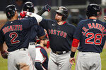 Boston Red Sox's Christian Vazquez, center, celebrates with Xander Bogaerts (2) and J.D. Martinez (28) after he hit a grand slam in the second inning of a baseball game against the Atlanta Braves on Saturday, Sept. 26, 2020, in Atlanta. (AP Photo/John Bazemore)