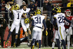 Michigan defensive back Ambry Thomas (1) celebrates his interception with defensive back Brandon Watson during the second half of an NCAA college football game against Rutgers, Saturday, Nov. 10, 2018, in Piscataway, N.J. (AP Photo/Julio Cortez)