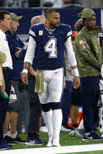 Dallas Cowboys quarterback Dak Prescott (4) watches from the sideline during the second half of the team's NFL football game against the Minnesota Vikings in Arlington, Texas, Sunday, Nov. 10, 2019. (AP Photo/Ron Jenkins)