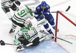 Dallas Stars goaltender Anton Khudobin (35) makes a save against Tampa Bay Lightning center Anthony Cirelli (71) as Stars' Tyler Seguin (91) defends during second-period NHL Stanley Cup finals hockey action in Edmonton, Alberta, Saturday, Sept. 19, 2020. (Jason Franson/The Canadian Press via AP)