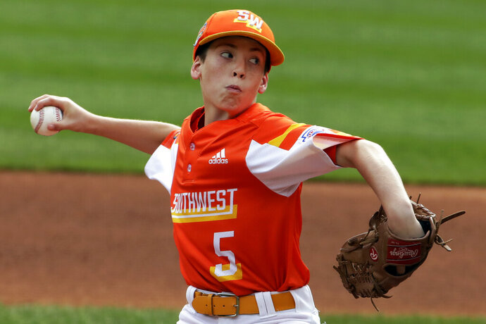 River Ridge, Louisiana's William Andrade delivers during the first inning of the United State Championship baseball game against Wailuku, Hawaii, at the Little League World Series tournament in South Williamsport, Pa., Saturday, Aug. 24, 2019. (AP Photo/Gene J. Puskar)
