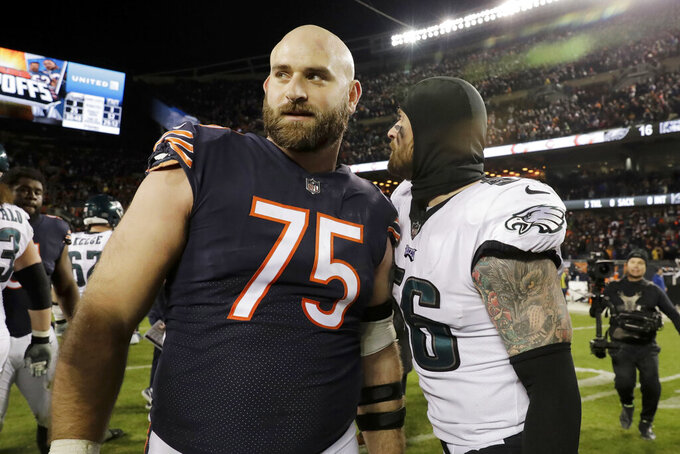 Philadelphia Eagles defensive end Chris Long (56) and his brother, Chicago Bears offensive guard Kyle Long (75), greet each other afterduring the second half of an NFL wild-card playoff football game Sunday, Jan. 6, 2019, in Chicago. (AP Photo/Nam Y. Huh)