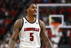 FILE - Louisville forward Malik Williams (5) smiles as he walks off the court during the second half an NCAA college basketball game against North Carolina Saturday, Feb. 22, 2020, in Louisville, Ky.  (AP Photo/Wade Payne, File)