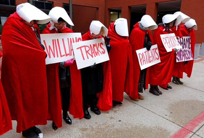 FILE - In this Oct. 31, 2019, file photo, Planned Parenthood supporters dressed In