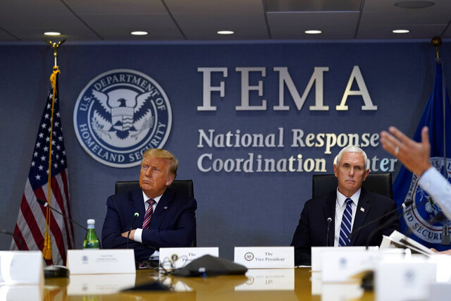 President Donald Trump and Vice President Mike Pence listen during a Hurricane Laura briefing at FEMA headquarters, Thursday, Aug. 27, 2020, in Washington. (AP Photo/Evan Vucci)