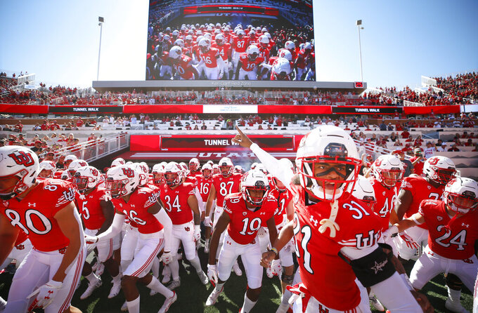 Utah cornerback LaCarea Pleasant-Johnson (31) leads his team into the field to play a game against Washington State at an NCAA college football game Saturday, Sept. 25, 2021, in Salt Lake City. (AP Photo/George Frey)