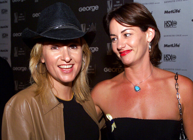 File - In this Aug. 16, 2000 file photo, Melissa Etheridge, left, and Julie Cypher arrive at a fundraiser for the Christopher Reeve Paralysis Foundation in Los Angeles. Etheridge's 21-year-old son Beckett Cypher, whom she had with former partner Julie Cypher, has died. The death was announced Wednesday on the singer-songwriter's Twitter account. No cause of death or other details were given. (AP Photo/Kevork Djansezian, File)