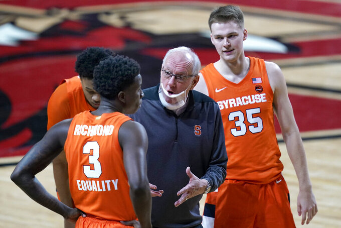 FILE - In this Saturday, Dec. 12, 2020, file photo, Syracuse head coach Jim Boeheim instructs his players during the second half of an NCAA college basketball game against Boston College, in Boston. Syracuse won the last two games on its revised regular-season schedule to remain in the hunt for a bid to the NCAA Tournament. (AP Photo/Elise Amendola, File)