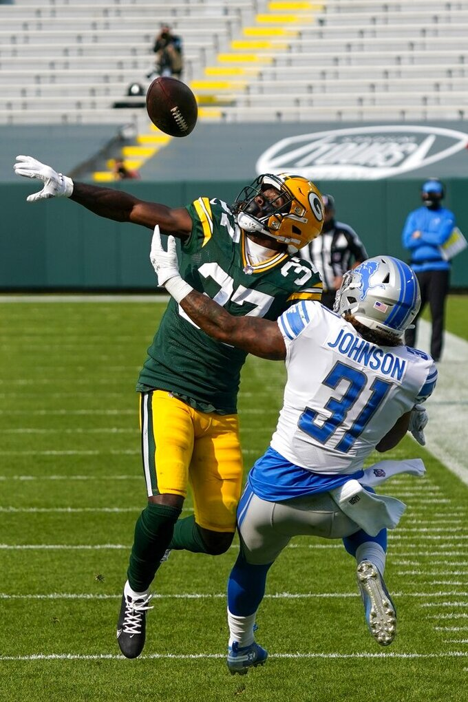 Green Bay Packers' Josh Jackson breaks up a pass intended for Detroit Lions' Ty Johnson during the second half of an NFL football game Sunday, Sept. 20, 2020, in Green Bay, Wis. (AP Photo/Morry Gash)