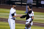 Arizona Diamondbacks relief pitcher Stefan Crichton, left, celebrates with catcher Carson Kelly after the team's 4-0 win over the Colorado Rockies in the first game of a baseball doubleheader Friday, Sept. 25, 2020, in Phoenix. (AP Photo/Ross D. Franklin)