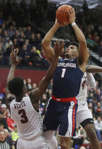 Gonzaga guard Admon Gilder (1) shoots between Santa Clara guard Trey Wertz (3) and guard Jalen Williams during the second half of an NCAA college basketball game in Santa Clara, Calif., Thursday, Jan. 30, 2020. (AP Photo/Jeff Chiu)