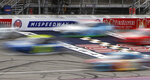 FILE - In this June 10, 2019, file photo, drivers race at the NASCAR cup series auto race at Michigan International Speedway in Brooklyn, Mich. With NASCAR set to return May 17, 2020, the iRacing Pro Invitational Series will likely go away. The NASCAR-backed iRacing Series, featuring the best sim racers in the field, will continue to run on digital platforms and six races will air on NBCSN during the series' playoffs. (AP Photo/Carlos Osorio, File)
