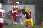 Southern Utah wide receiver Lance Lawson (14) pulls in a pass as Arizona State defensive back DeAndre Pierce (2) defends during the first half of an NCAA college football game, Thursday, Sept. 2, 2021, in Tempe, Ariz. (AP Photo/Matt York)