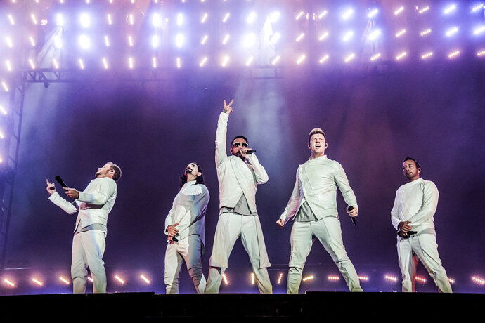 """FILE - In this  July 9, 2017, file photo, Brian Littrell, from left, Kevin Richardson, AJ McLean, Nick Carter and Howie Dorough of the Backstreet Boys perform during the Festival d'ete de Quebec in Quebec City, Canada. The Backstreet Boys have a new single. They released """"Don't Go Break My Heart"""" on Thursday, May 17, 2018, along with a video. (Photo by Amy Harris/Invision/AP, File)"""