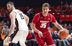 Wisconsin forward Nate Reuvers (35) moves the ball around Illinois forward Giorgi Bezhanishvili (15) during the second half of an NCAA college basketball game in Champaign, Ill., Wednesday, Jan. 23, 2019. (AP Photo/Stephen Haas)