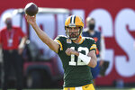 Green Bay Packers quarterback Aaron Rodgers (12) throws a pass against the Tampa Bay Buccaneers during the first half of an NFL football game Sunday, Oct. 18, 2020, in Tampa, Fla. (AP Photo/Jason Behnken)
