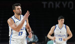 Italy's Giampaolo Ricci (17), left, celebrates a score against Nigeria during men's basketball preliminary round game at the 2020 Summer Olympics, Saturday, July 31, 2021, in Saitama, Japan. (AP Photo/Eric Gay)