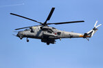 A Russian army helicopter MI-35 performs during a military parade at the military airport Batajnica, near Belgrade, Serbia, Saturday, Oct. 19, 2019. Medvedev arrived on a one-day official visit to Serbia during which he attend military parade commemorating the 75th anniversary of the liberation of the Serbian capital from the Nazi German occupation by the Red Army and Communist Yugoslav Partisans. (AP Photo/Darko Vojinovic)