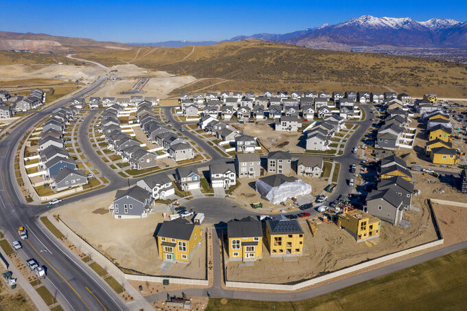 New home construction in Saratoga Springs on Thursday, Dec. 3, 2020. Utah's population swelled by an estimated 52,820 people — equivalent to adding a city the size of Herriman — during the fiscal year that ended July 1, 2020, as a years-long economic boom ended and the pandemic and its recession began. (Rick Egan/The Salt Lake Tribune via AP)