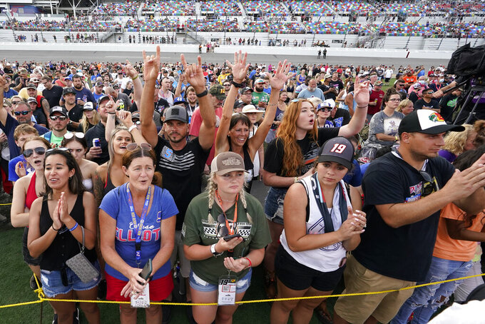 Fans cheer during driver introductions before the NASCAR Cup Series auto race at Daytona International Speedway, Saturday, Aug. 28, 2021, in Daytona Beach, Fla. (AP Photo/John Raoux)
