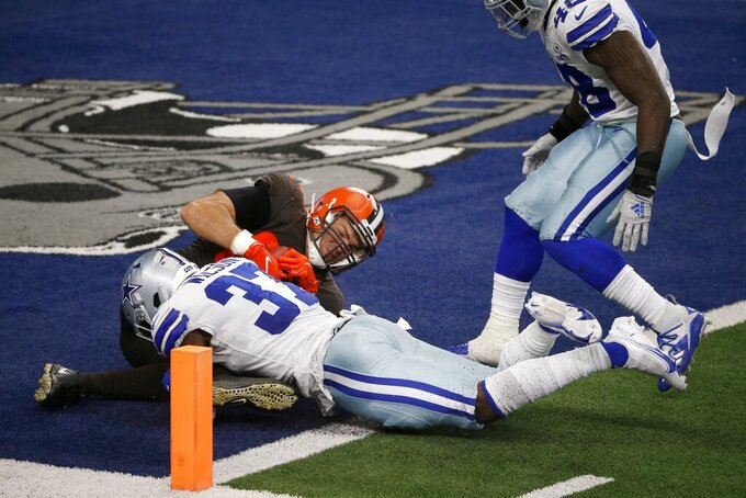 Dallas Cowboys safety Donovan Wilson (37) and linebacker Joe Thomas (48) defend as Cleveland Browns tight end Stephen Carlson (89) lands on the ball in the end zone for a two-point conversion late in the second half of an NFL football game in Arlington, Texas, Sunday, Oct. 4, 2020. (AP Photo/Michael Ainsworth)
