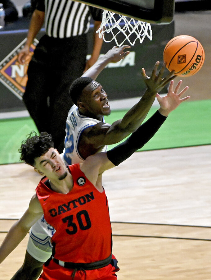 Memphis center Moussa Cisse (32) goes after a rebound with Dayton forward Mustapha Amzil (30) in the first half of an NCAA college basketball game in the first round of the NIT Tournament, Saturday, March 20, 2021, in Denton, Texas. (AP Photo/Matt Strasen)