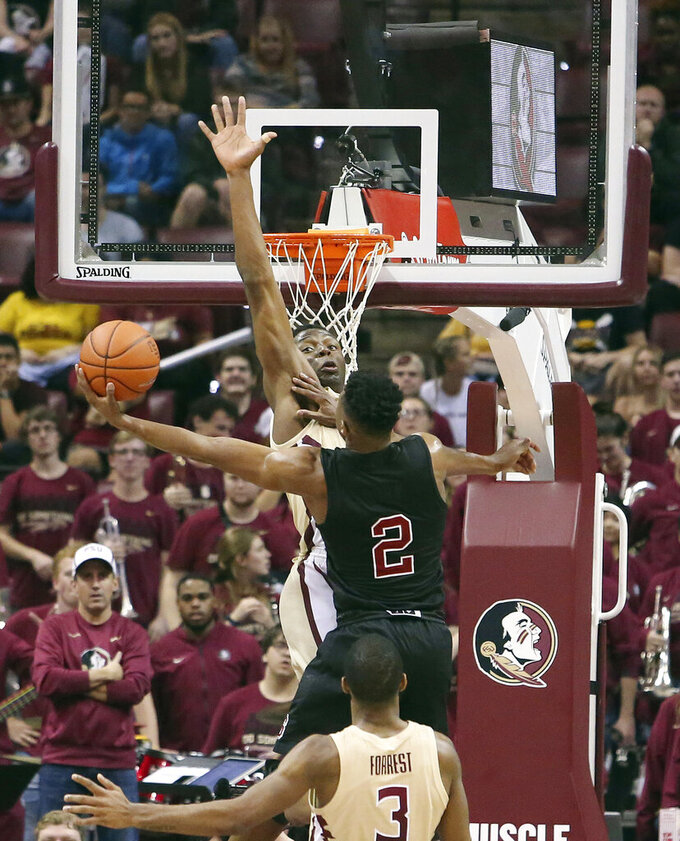 North Carolina State's Torin Dorn tries to go around Florida State's Mfiondu Kabengele as he attempts a shot in the second half of an NCAA college basketball game Saturday, March 2, 2019, in Tallahassee, Fla. Florida State won 78-73. (AP Photo/Steve Cannon)