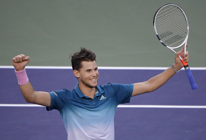 Dominic Thiem, of Austria, celebrates after defeating Roger Federer, of Switzerland, in the men's final at the BNP Paribas Open tennis tournament Sunday, March 17, 2019, in Indian Wells, Calif. Thiem won 3-6, 6-3, 7-5. (AP Photo/Mark J. Terrill)