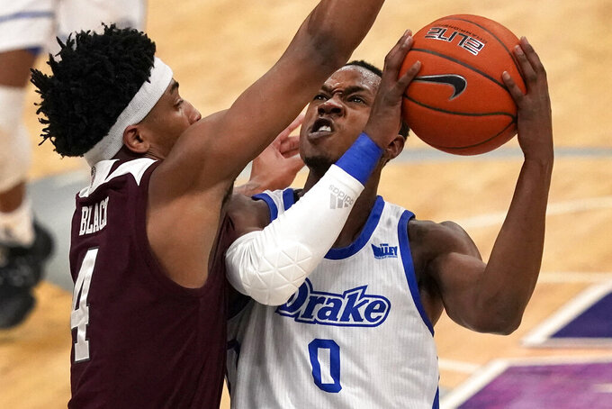Drake's D.J. Wilkins (0) heads to the basket as Missouri State's Ja'Monta Black (4) defends during the first half of an NCAA college basketball game in the semifinal round of the Missouri Valley Conference men's tournament Saturday, March 6, 2021, in St. Louis. (AP Photo/Jeff Roberson)