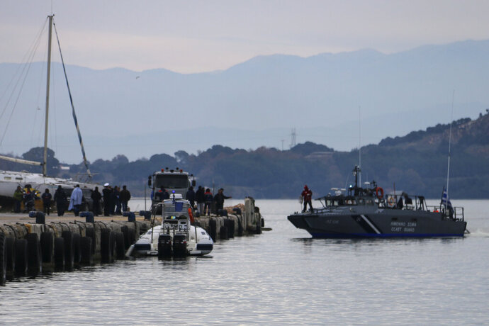 A Greek coastguard vessel approaches the port of Preveza, northwestern Greece, Saturday, Jan. 11, 2020. Greece's coast guard says 12 migrants have been found dead in the Ionian Sea and 21 others have been rescued after their boat took in water and sank. Searchers are looking for more survivors. (Andriana Soldatou/mypreveza.gr via AP)