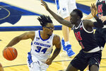 Creighton's Denzel Mahoney (34) drives to the basket against Nebraska's Lat Mayen (11) during the second half of an NCAA college basketball game in Omaha, Neb., Friday, Dec. 11, 2020. (AP Photo/Nati Harnik)