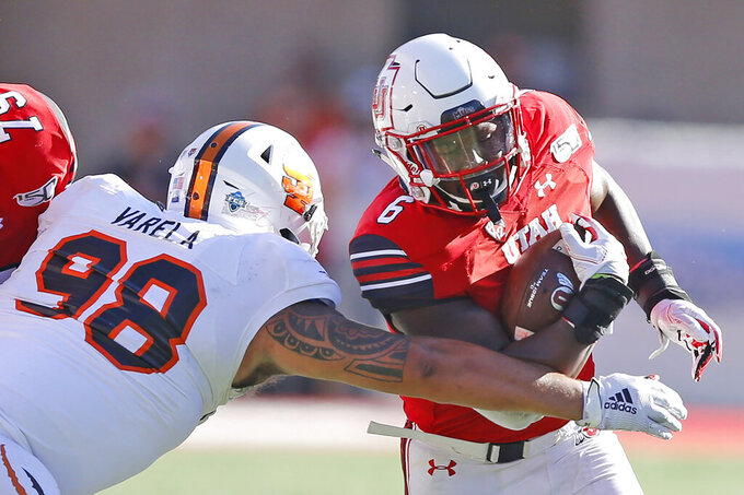 FILE - In this Sept. 14, 2019, file photo, Idaho State defensive lineman Gilbert Varela reaches for Utah running back Devin Brumfield during the second half of an NCAA college football game in Salt Lake City. Devin Brumfield, Jordan Wilmore, Micah Bernard and Ty Jordan will split carries this season. (AP Photo/Rick Bowmer, File)