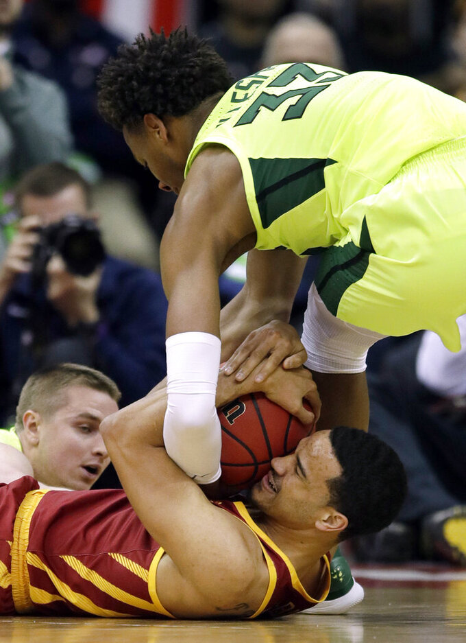 Baylor forward Freddie Gillespie (33) ties up Iowa State guard Nick Weiler-Babb, bottom, during the first half of an NCAA college basketball game in the quarterfinals of the Big 12 conference tournament in Kansas City, Mo., Thursday, March 14, 2019. (AP Photo/Orlin Wagner)
