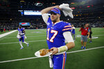 Buffalo Bills' Josh Allen waves a towel motivating fans as he walks off the field with a turkey leg that was presented to him during a post game broadcast interview following their NFL football game against the Dallas Cowboys in Arlington, Texas, Thursday, Nov. 28, 2019. (AP Photo/Michael Ainsworth)