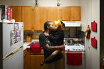 Shanta Russ, 22, kissed her daughter, Siya Freeman, 4, after being allowed back up to her father's 15th floor apartment, following a fire on the 14th floor in Minneapolis on Wednesday, Nov. 27, 2019. Several people died and three were injured when the fire broke at the public housing high-rise in a heavily immigrant neighborhood of Minneapolis early Wednesday. (Aaron Lavinsky/Star Tribune via AP)