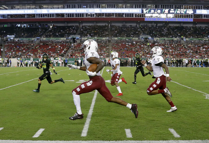 Temple running back Jager Gardner, center, runs for a first down against South Florida during the first half of an NCAA college football game Thursday, Nov. 7, 2019, in Tampa, Fla. (AP Photo/Chris O'Meara)