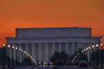 FILE - In this May 20, 2016, file photo, traffic rolls across the Memorial Bridge toward the Lincoln Memorial at sunrise in Washington. The PBS host Geoffrey Baer is back this summer with new episodes of his series