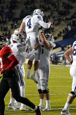 BYU running back Lopini Katoa (4) celebrates with teammates after scoring against Western Kentucky during the first half of an NCAA college football game Saturday, Oct. 31, 2020, in Provo, Utah. (AP Photo/Rick Bowmer, Pool)