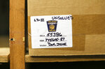 In this Monday, Nov. 4, 2019 photo, evidence from an unidentified murder victim is boxed in an evidence room at the Toledo Police Department in Toledo, Ohio. In the basement of the Toledo Police Department, more than 20,000 items collected from crime scenes across the city each year are stored to help verify what happened or to be used to find and convict suspects.  (Andy Morrison/The Blade via AP)