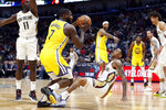Golden State Warriors forward Eric Paschall (7) fouls New Orleans Pelicans guard Nickeil Alexander-Walker in the first half of an NBA basketball game in New Orleans, Sunday, Nov. 17, 2019. (AP Photo/Tyler Kaufman)
