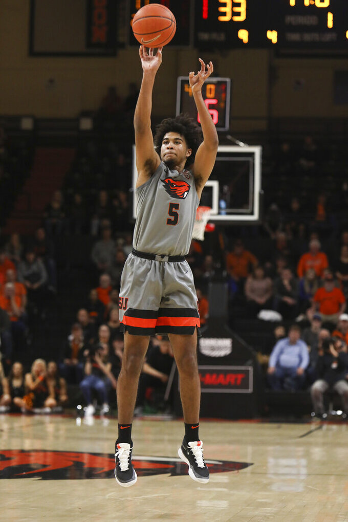 Oregon State's Ethan Thompson shoots a 3-pointer during the first half of the team's NCAA college basketball game against Utah in Corvallis, Ore., Thursday, Feb. 13, 2020. (AP Photo/Amanda Loman)
