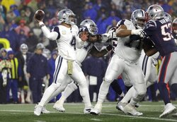 Dallas Cowboys quarterback Dak Prescott drops back to pass against the New England Patriots in the first half of an NFL football game, Sunday, Nov. 24, 2019, in Foxborough, Mass. (AP Photo/Elise Amendola)