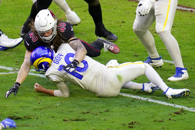 Arizona Cardinals linebacker Dennis Gardeck (45) sacks Los Angeles Rams quarterback Jared Goff (16) during the first half of an NFL football game, Sunday, Dec. 6, 2020, in Glendale, Ariz. (AP Photo/Ross D. Franklin)