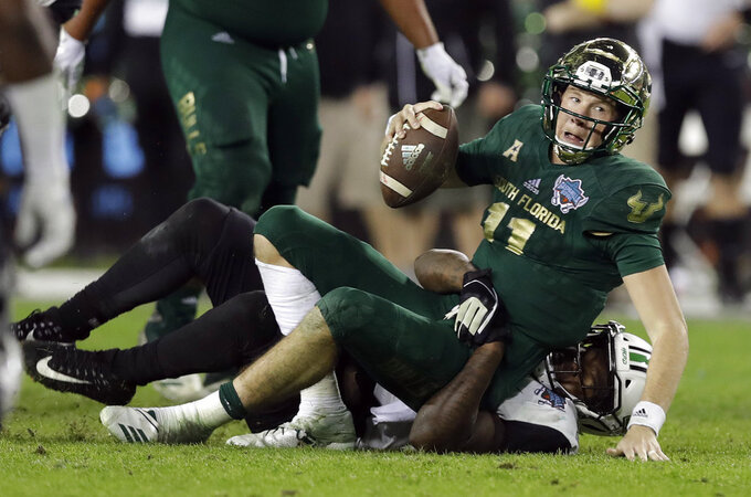 South Florida quarterback Blake Barnett (11) is sacked by Marshall defensive lineman Ty Tyler during the second half of the Gasparilla Bowl NCAA college football game Thursday, Dec. 20, 2018, in Tampa, Fla. (AP Photo/Chris O'Meara)