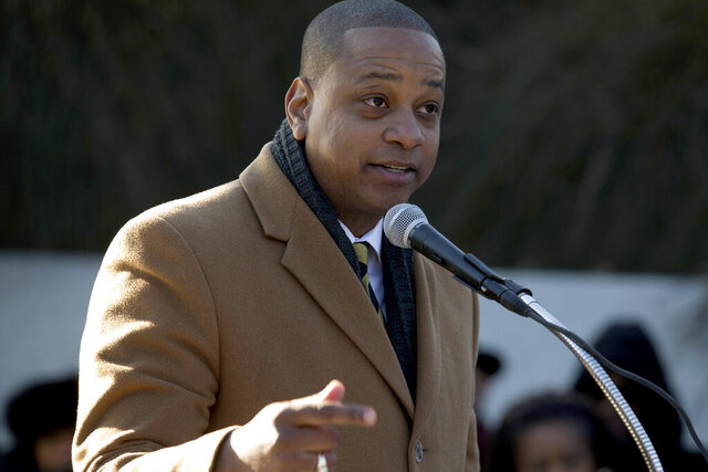 FILE - In a Monday, Jan. 20, 2020 file photo, Virginia Lt. Governor Justin Fairfax speaks during the 9th Annual wreath laying and  ceremony at the Martin Luther King Jr. Memorial, in Washington. District Judge Anthony Trenga in Alexandria has tossed out a libel lawsuit filed by Virginia Lt. Gov. Justin Fairfax against CBS, who he accused of slanted reporting on sexual assault allegations levied against him. U.S. District Judge Anthony Trenga in Alexandria dismissed the case against CBS on Tuesday, Feb. 11, 2020. (AP Photo/Jose Luis Magana, File)