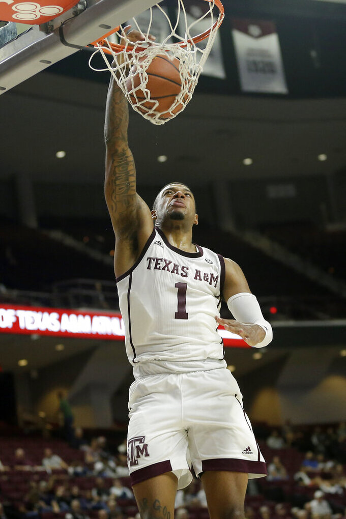 Texas A&M guard Savion Flagg (1) dunks on a fast break against Northwestern State during the second half of an NCAA college basketball game Wednesday, Nov. 6, 2019, in College Station, Texas. (AP Photo/Sam Craft)