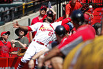 St. Louis Cardinals right fielder Dexter Fowler dives into the stands but is unable to catch a foul ball by Pittsburgh Pirates' Starling Marte during the ninth inning of a baseball game Wednesday, July 17, 2019, in St. Louis. The Cardinals won 6-5. (AP Photo/Jeff Roberson)