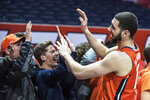 Illinois' Giorgi Bezhanishvili celebrates a 71-62 win over Michigan with the fans in the second half of an NCAA college basketball game, Wednesday, Dec. 11, 2019, in Champaign, Ill. (AP Photo/Holly Hart)